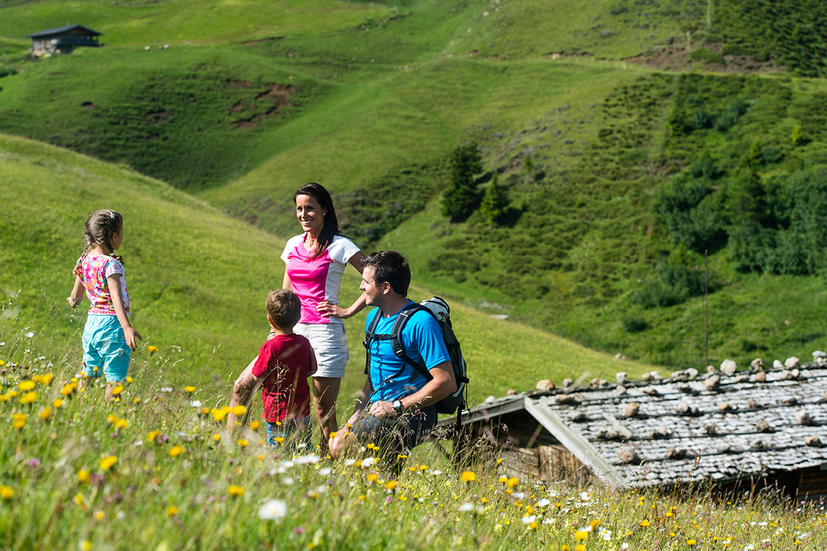 Hiking with children on the beatiful Alpe di Siusi in the Dolomites